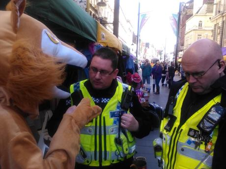 Freddy Fox explaining to some local bobbies why people shouldn't wear fur!